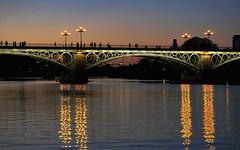 On the bridge to Triana (marthareichardt) Tags: sevilla guadalquivir andalucia bridge reflexions spain andalusien puentedetriana puentedeisabelii sonnenuntergang sunset coucherdusoleil puestadelsol españa triana romantique romantico