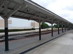 Amtrak Loading Platform. (dccradio) Tags: fayetteville nc northcarolina cumberlandcounty outdoor outdoors outside sky clouds cloudy cloudyday overcast amtrak depot station amtrakstation trainstation june summer saturday weekend saturdaymorning goodmorning morning samsung galaxy smj727v j7v cellphone cellphonepicture light lights awning pole poles bike bicycle deck loadingdeck building architecture tree trees greenery