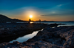 moments on the rocks (mare_maris) Tags: sea water sky sun people man woman dog landscape sunset moments maremaris afpnikkor1020 nikon d750 rocks skyscape paesaggio tramonto mare cielo acqua persone cane uomo donna paisaje puestadesol mar agua gente perro hombre mujer landschaft sonnenuntergang meer himmel wasser leute hund mann 风景 日落 海 天空 水 男人 女人 ηλιοβασίλεμα θαλασσα ουρανόσ νερό άνθρωποι σκυλοσ άνδρασ γυναίκα 剪影 silhouettes mood happiness serene greece hellas greek mediterranean europe