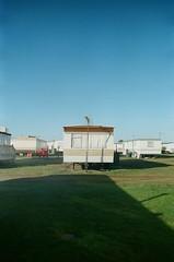 30860010 (thophi24) Tags: 35mm analog analogue trailer park holiday olympus olympusom10 fuji