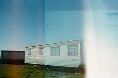 30860015 (thophi24) Tags: 35mm analog analogue trailer park holiday olympus olympusom10 fuji lightleak