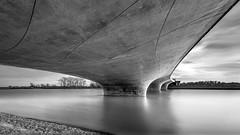 Concrete meets engineering (frank_w_aus_l) Tags: brücke bridge nijmegen netherlands nikon d810 nikkor 1424 longexposure water monochrome sw bw noiretblanc architecture sky stream reflection concrete calm lent provinzgelderland niederlande