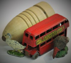 Childhood Toys,  for   Macro Mondays. (the.haggishunter) Tags: top wooden spinning matchbox red bus farm bird models metal childhood childhoodtoys toys macro macromondays