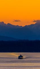The Purple Mountain and the Ferry (sbisson) Tags: sunset seattle elliottbay olympics pugetsound ship bay washington evening sun sky orange purple