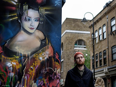 Geisha on my mind (Silver Machine) Tags: london bricklane streetphotography street candid graffiti dankitchener streetart man walking beanie fujifilm fujifilmxt10 fujinonxf35mmf2rwr