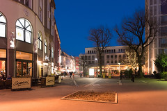 ELBERFELD, GERMANY - FEBRUARY 15, 2017: The warm weather attracts shoppers and restaurant guests even after sundown (axel-d-fischer) Tags: modern retail vividtown elberfeld historic shopping stylish shoppers germany architecture stores richofferings light wuppertalelberfeld downtown