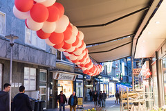 ELBERFELD, GERMANY - FEBRUARY 15, 2017: Unidentified pedestrants pass by the decoration made of ballons of a flower shop (axel-d-fischer) Tags: modern retail vividtown elberfeld historic shopping stylish shoppers germany architecture stores richofferings light wuppertalelberfeld downtown