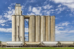 Grain Storage (Kool Cats Photography over 12 Million Views) Tags: grainstorage agriculture farming clouds architecture bluesky blue oklahoma outdoor train railroad railcar tall building structure grass