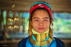 Young Padaung Long Neck Woman Thailand - Ben Heine Photography (Ben Heine) Tags: mother portrait clothing jewel asia cute ywama coils young animism hill ring longneckwoman female hat discovery kayan woman clothes chiang karen village thailand asian tradition beauty legend padaung teen old happiness women tribe neck traditional people myanmar minority culture pride colorful buddhism religion smile travel ethnic tourism necklace burma pretty work traditionalclothes proud goldenrings