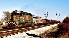 SBD 8114, CSX 1771 (EMD SD40-2, GP16) @ Walkerton  IN (hardhatMAK) Tags: sbd8114 csx1771 emdsd402 emdgp16 freighttrain westbound 7251987 kodachrome64 scannedslide walkertonin familylines