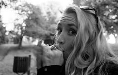 Bird Calls (Mano Green) Tags: woman park tree canon eos 300 400mm lens ilford hp5 400 35mm film black white portrait person glasgow scotland uk city summer june 2016 ilfosol s epson perfection v550