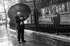 Head Space (gothick_matt) Tags: trafalgarsquare man london street smoker umbrella places nationalgallery uk headspace unitedkingdom