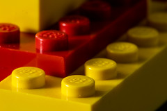 MacroLegos (Lo8i) Tags: childhoodtoys twocolours flickrlounge lego macro macromondays red toys yellow