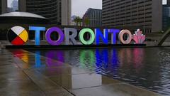 We the north! #Toronto #cityhall (remiklitsch) Tags: ontario canada remiklitsch iphone neon letters reflection night rain urban city color toronto cityhall