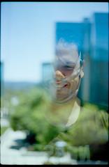 the one who stares (Duke of Gnarlington) Tags: kodak ektar 100 canon ae1 analog film 50mm 18 tape portrait face office playstation