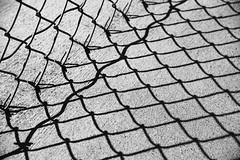 Linked (SoxFanInSD) Tags: shadows fence blackwhite bw