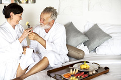 A senior couple enjoying room service (towelnrobe) Tags: adult anniversary breakfast breakfastinbed caucasian continental couple dressinggown elderly emotion enjoying european feed feeling food fullbreakfast happiness holiday honeymoon hotel husband love man marriage matureadult meal oldpeople people relationship resort retired retirement robes romance romantic roomservice senioradult service summer sweet together travel trip tropical vacation valentines weekend westerner wife woman
