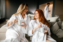 Women relaxing and drinking tea (towelnrobe) Tags: woman spa enjoying wellness tea people relaxed relaxation drink lifestyle towel bodycare healthy person beauty caucasian weekend cup hotel health herbal drinking day couch detox looking gown escape guest relax pretty pure young robe room silence trip luxury teacup comfy dayspa cheerful charming attractive resting lovely happy friends