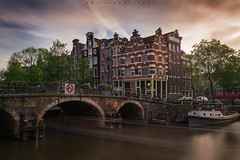 Meeting for 2. (Emykla) Tags: amsterdam netherlands holland olanda canale acqua water cielo sky clouds nuvole case houses canal nikond3100 sunset tramonto europa europe