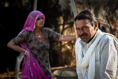 Bishnoi family in front of their barn. Bishnoi are a religious sect in Northern India that focuses on being gentle to all life forms. The family seemed extremely genuine, leaving in tune with nature, with no interest in the buzz of the surrounding world. (Catherine Gidzinska and Simon Gidzinski) Tags: 2018 bishnoivillage friday india november rajasthan gidzinska gidzinski grainconnoisseur pali woman man portrait family bishnoi