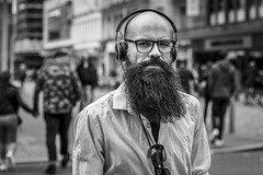 Sounds of the Street (Leanne Boulton) Tags: urban street candid portrait portraiture streetphotography candidstreetphotography candidportrait streetportrait eyecontact candideyecontact streetlife man male face eyes expression emotion mood feeling headphones beard style fashion tone texture detail depthoffield bokeh naturallight outdoor light shade city scene human life living humanity society culture lifestyle people canon canon5dmkiii 70mm ef2470mmf28liiusm black white blackwhite bw mono blackandwhite monochrome glasgow scotland uk