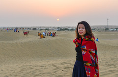 A young woman standing on desert (phuong.sg@gmail.com) Tags: alone back beach beaches beautiful beauty blue cadiz clouds costume desert dress dune female girl ground indian landscape leh leisure lifestyle light lonely mountain nature one outdoor park rajasthan retro sand sky standing summer sun tourist traditional travel vacation valley vintage walk walking wedding woman young