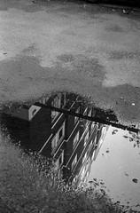 Flat Water (Mano Green) Tags: flats block puddle street road tarmac glasgow scotland city uk june summer 2016 canon eos 300 40mm lens ilford hp5 400 35mm film ilfosol s epson perfection v550 black white portrait