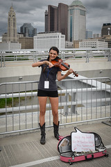 Skyline Strings (tim.perdue) Tags: fiddler violinist fiddle violin columbus arts festival ohio downtown urban city artsfest main street bridge girl woman person figure musician performer bow strings neck scroll musical instrument portrait candid nikon d5600 nikkor 1680mm solo acoustic concert performance art gcac greater council scioto mile riverfront