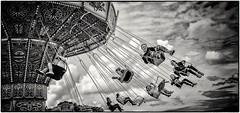 Airborne (Andy J Newman) Tags: monochrome bw bandw beaufort beaufortclub blackandwhite d500 fairground gloucestershire gloucestershirefestivalofpolo nikon polo roundabout silverefex swing tetbury england unitedkingdom