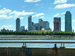 A Beautiful Day in East River, New York (soniaadammurray - On & Off) Tags: iphone newyork landscape water river skyline architecture sky clouds trees driving shadows reflections martedidinuvole martesdenubes look artchallenge nicewonderfultuesdayclouds exterior