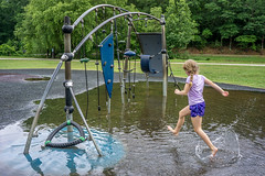 Breaking through (agasfer) Tags: 2019 southcarolina greenville sony a6000 sonye2820 kids children zoo playground water puddle