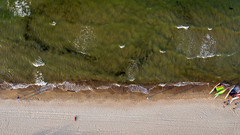 Slow waves (piotr_szymanek) Tags: renia reniag woman young skinny face portrait outdoor beach sand water sea baltic wave drone fromabove 1k 5k 20f 10k