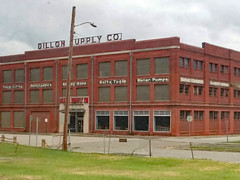 Dillon Supply Building. (dccradio) Tags: rockymount nc northcarolina edgecomecounty nashcounty outdoor outdoors outside june summer weekend saturday afternoon goodafternoon saturdayafternoon clouds cloudy overcast sky architecture structure building samsung galaxy smj727v j7v cellphone cellphonepicture dillonsupplycompany retail store sign words text window windows door entrance brick brickbuilding forklifts steel pipe warehouse waterpumps paintladders hoses deltatools streetlight lightpole lamppost grass lawn greenery yard paved pavement street fence