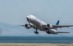 united flight 390 takeoff to chicago (pbo31) Tags: bayarea california sanmateocounty nikon d810 color june 2019 boury pbo31 sanfranciscointernational sfo airport aviation airline plane travel sanbruno over united boeing 777 blur departure takeoff motion runway blue