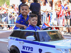 Puerto Rican Parade 2019 NYC (tai_lee2) Tags: parade celebration festival traditional national puerto rican new york city street sign flag banner people person costume barrier toy vehicle