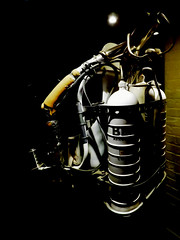James Bond's Jet Pack (Steve Taylor (Photography)) Tags: jamesbond jetpack cylinders pipes model museum black brown dark contrast white metal uk gb england greatbritain unitedkingdom london bondinmotionjamesbondexhibition londonfilmmuseum