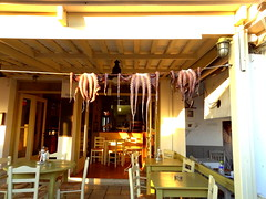 Restaurant with Octopus Decorations (dimaruss34) Tags: newyork brooklyn dmitriyfomenko image greece naxos restaurant decorations octopus tables chairs door