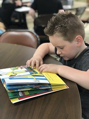 """BELL student reading Braille book to a mentor • <a style=""""font-size:0.8em;"""" href=""""http://www.flickr.com/photos/29389111@N07/48046550517/"""" target=""""_blank"""">View on Flickr</a>"""
