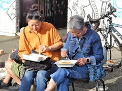 Mother and Daughter Reunion (knightbefore_99) Tags: commercialdrive italian italy party eastvan vancouver sol sun sunny 2019 car free day awesome mother daughter left right eat sit sidewalk