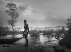The Boatman .. (tchakladerphotography) Tags: bw blackwhite boat waterfall water waves weather man misty morning trees sky sand person portrait india travel