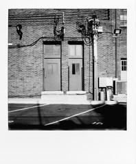 untitled-6 (dvlmnkillatron) Tags: film polaroid sx70 slr670s polaroidoriginals analog instantfilm bw doors cables champaign