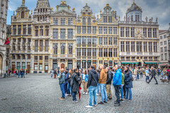 look there ! (stevefge (away)) Tags: belgium brussel brussels bruxelles grandplace crowds group tourists street people candid unsuspectingprotagonists unsuspecting reflectyourworld nikon cobbles squares plein buildings architecture gold men women