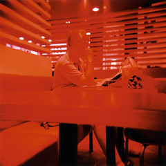 All is full of red (ale2000) Tags: analog analogue lomography colornegative400 holga film 120 6x6 pellicola xpro crossprocessed crossprocessing xproed filmisnotdead believeinfilm red bathed streetphotography newspaper bar seated sitting loneliness alone lonely man stranger candid everythingred allisfullofred alliseeisred redeverywhere