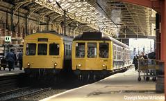 Side-By-Side DMUs At Preston (Michael McNicholas) (Neil Harvey 156) Tags: railway preston dmu westcoastmainline wcml multipleunit brblue prestonstation class101 railblue class108 derbybuilt firstgenerationdmu michaelmcnicholas ch353 lo255 metropolitancammell