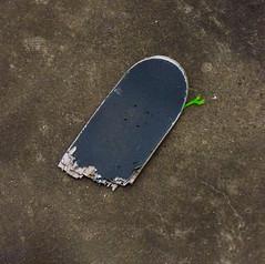 Death by Skateboard (Steve Taylor (Photography)) Tags: alien skateboard broken snapped hand crushed minimalist minimalism brown green vivid concrete wood uk gb england greatbritain unitedkingdom london texture