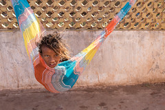 Candid Portrait, Kanyakumari (Geraint Rowland Photography) Tags: tamil tamilnadu statesofindia india indiantravel peopleofindia tamiltigers tamilchild indianchildren candid colours colourful hammock candidportrait kanyakumari geraintrowlandcandidphotography wwwgeraintrowlandcouk canonindia indianexplore wanderlust life hair dreadlocks peace people