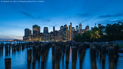 Twilight Pilings (20190609-DSC06325) (Michael.Lee.Pics.NYC) Tags: newyork brooklyn brooklynbridgepark pilings eastriver lowermanhattan wtc worldtradecenter night twilight bluehour reflection architecture cityscape sony a7rm2 laowa12mmf28 magicshiftconverter