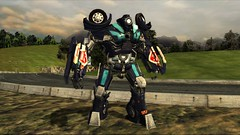 Payload (Deluxe) #2 (BarricadeCaptures) Tags: transformers transformersthegame thesuburbs tranquility decepticon decepticondrone dronearmouredcar transformerspayload payloadtransformers decepticonpayload payload deluxepayload road trees gamescreenshots gamephotography videogame screencapture screenshot screencap