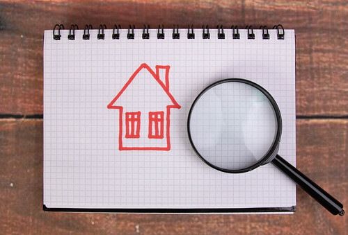 Hand drawn house with magnifying glass