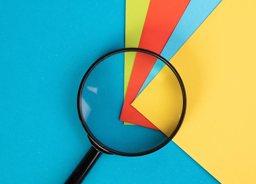 Magnifying glass with colorful sticky notes